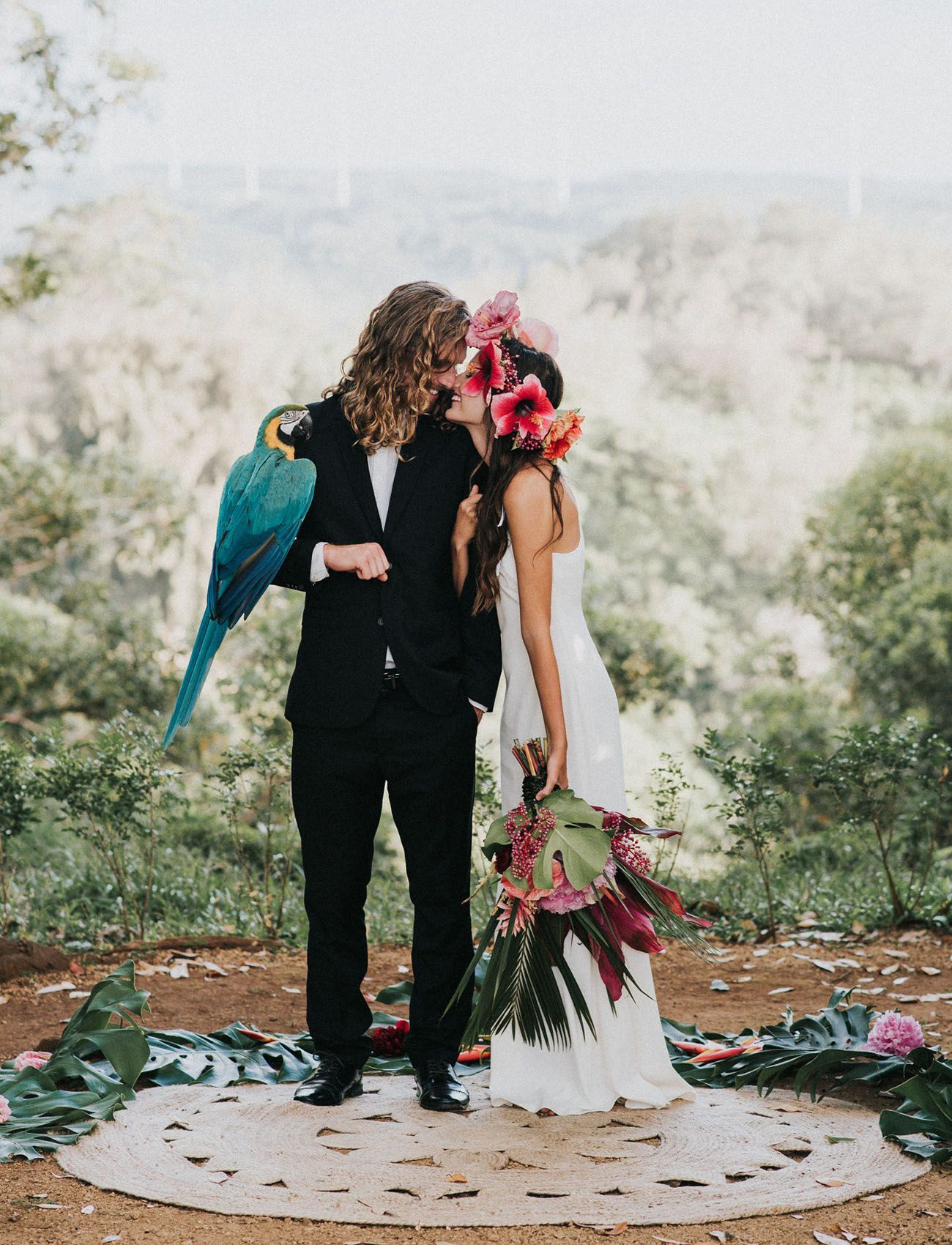 Boho hawaii inspiration with hibiscus floral crown macaw
