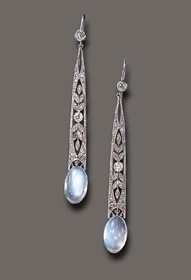 A PAIR OF MOONSTONE AND DIAMOND EAR PENDANTS   Each old European-cut diamond collet, suspending a rose and old European-cut diamond elongated openwork plaque, to the cabochon moonstone terminal, mounted in platinum. Edwardian or Edwardian style