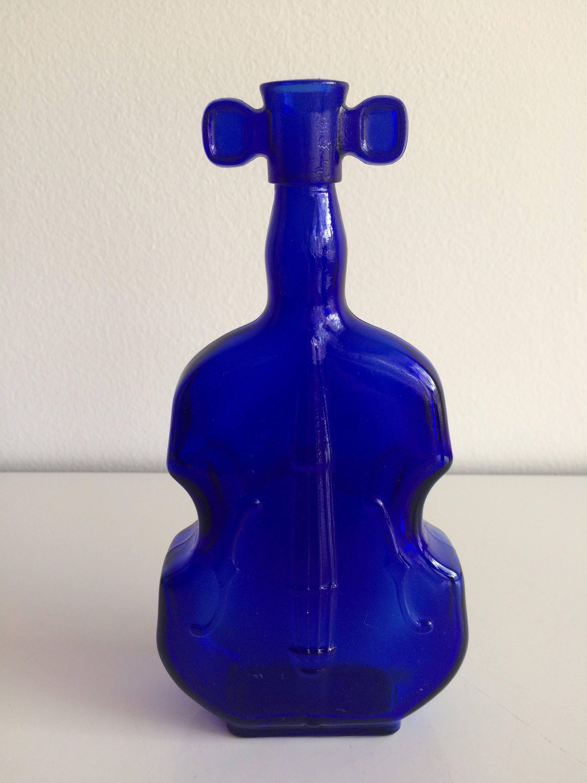 Vintage cobalt blue violin glass vase cobalt blue cobalt and glass find this pin and more on vintage violin cello vase by schmidtl5855 reviewsmspy