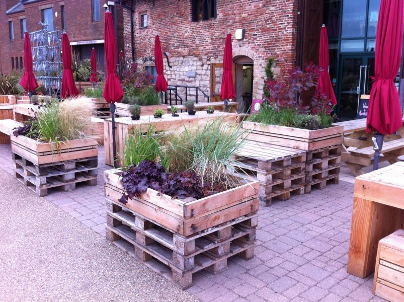 tables chairs made out of pallets at the quay side in kings lynn - Garden Furniture Kings Lynn