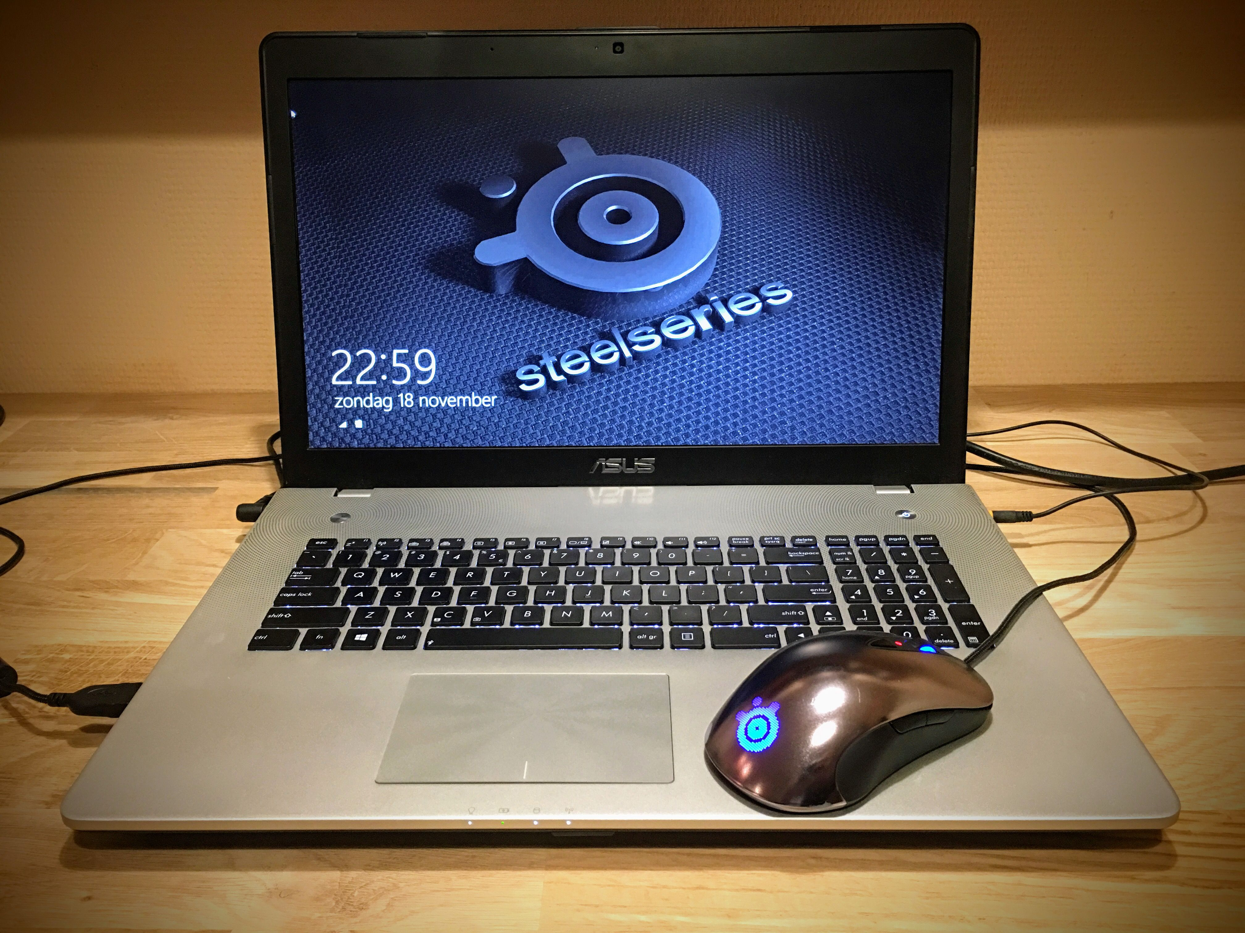 Asus Laptop With A Steelseries Sensei Gaming Mouse