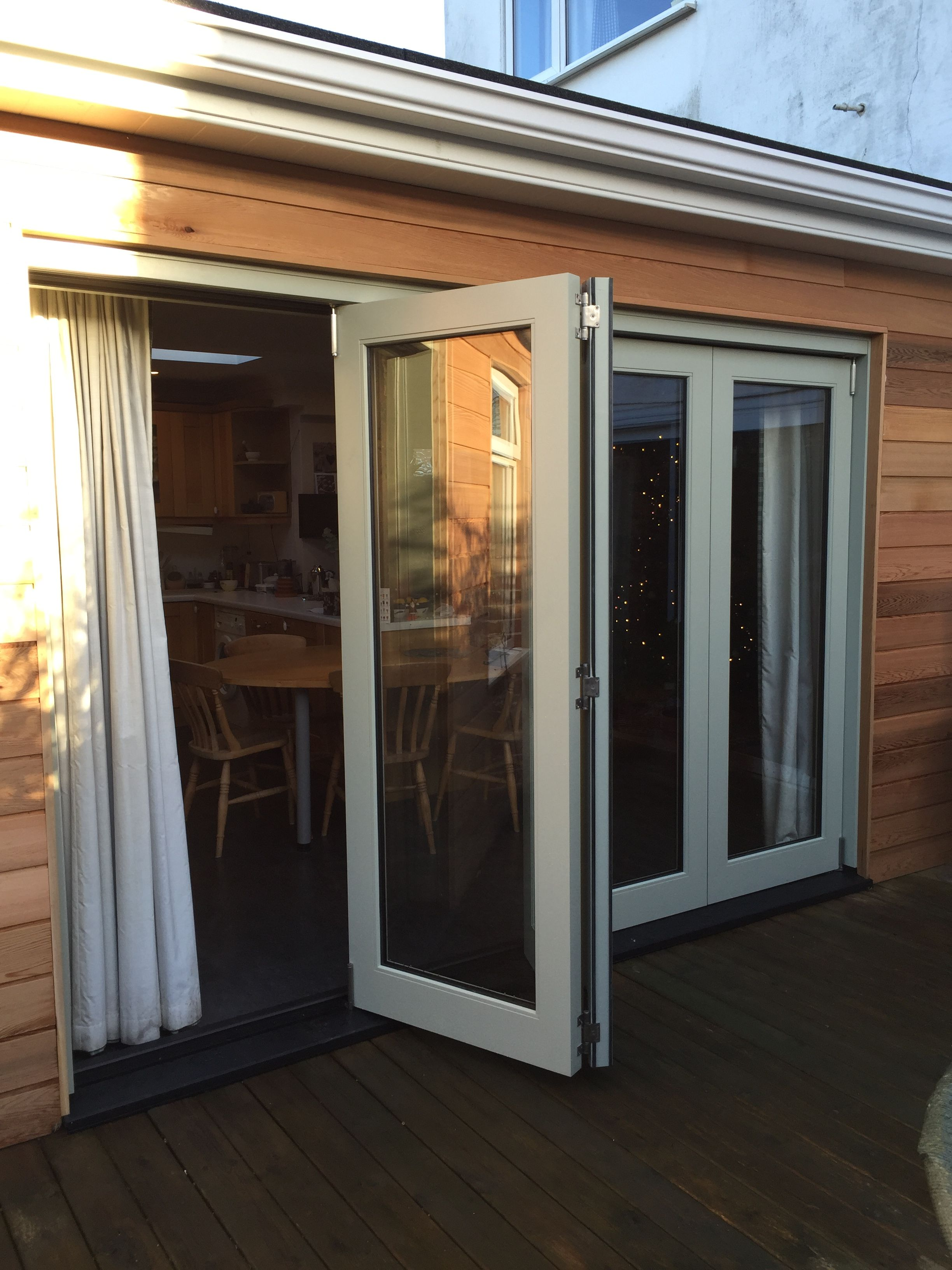 Medina Joinery  Painted occoya bifold doors  Medina Joinery  Window frames Garage doors