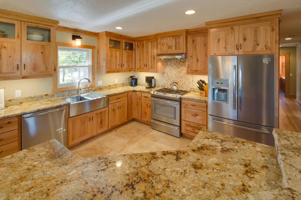 Rustic Kitchen with Wall sconce, Kitchen island with seating