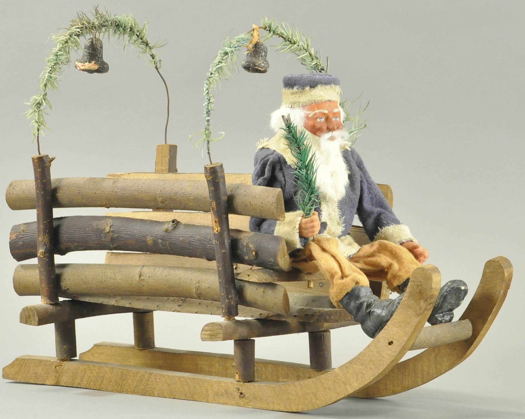 Log sleigh with feather tree boughs is ready to be loaded with Christmas gifts, early version ...