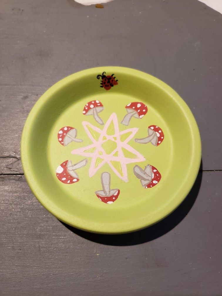 Fae fairy offering plate made from a small gardening pottery