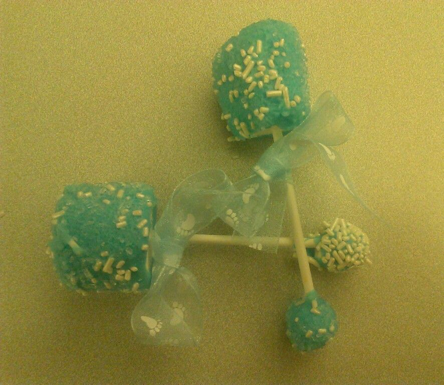 Baby Rattles: Large marshmallows and small marshmallows on either end of a cake pop stick. Dip in blue or pink cake sprinkles and can add the white oblong sprinkles too (not sure how the sprinkles stick to the marshmallows - I did not make these). Tie with a blue or pink baby ribbon to the stick.