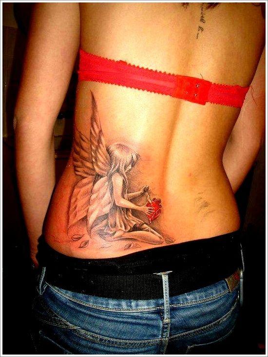 très belle fée tatoué dans le bas du dos avec des effets d'ombrage