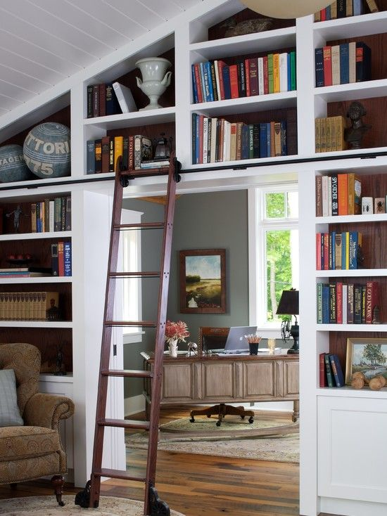 Library Wall in Family Room leads into a home office with the desk angled  into the