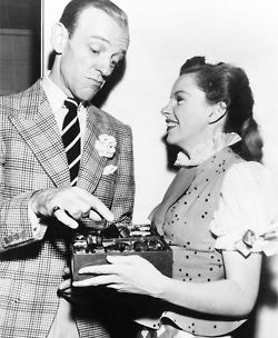Fred Astaire and Judy Garland eating chocolates on the set of Easter Parade