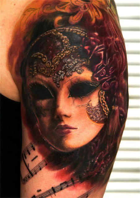 ridiculously perfect mask tattoo with purple and gold