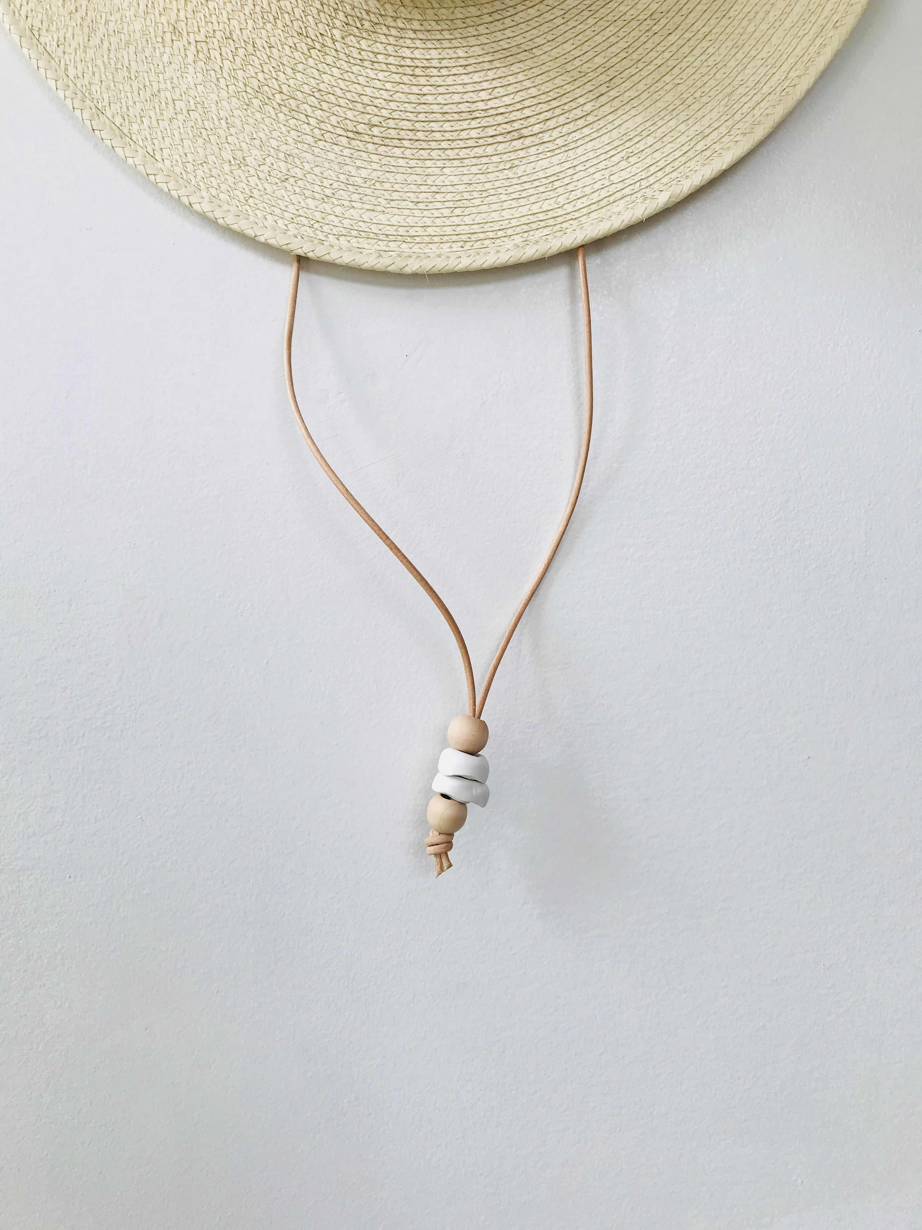 417c4f8c Custom stampede cord with hand-made clay + hand-churned birch wood beads.  Find this Pin and more on Desert Sun Hat Collection by west perro.
