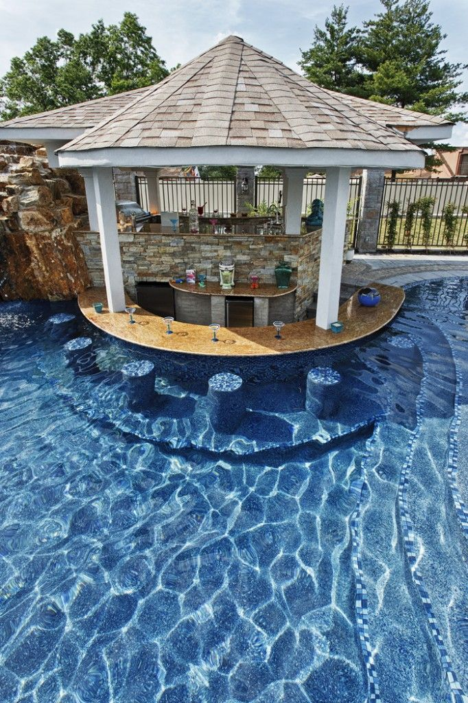A Vacation E In Your Own Backyard Pool Waterfall Outdoor Kitchen Belly Up To The Bar