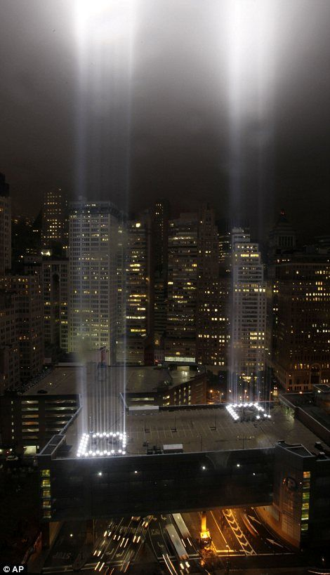 Twinkling tribute to the Twin Towers: World Trade Center rises in poignant pillars of light as New York makes final preparations for 9/11 anniversary