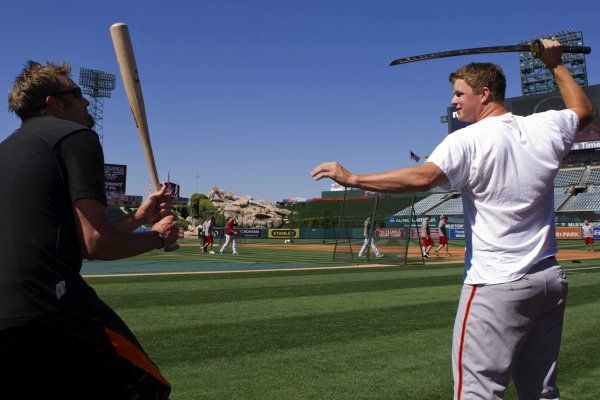 SF Giants pitcher Matt Cain plays with his samurai sword, presented to him by Mizuno in commemoration of his perfect game. (Cameo by reliever Jeremy Affeldt.) We love this.   via The Splash | an SFGate.com blog