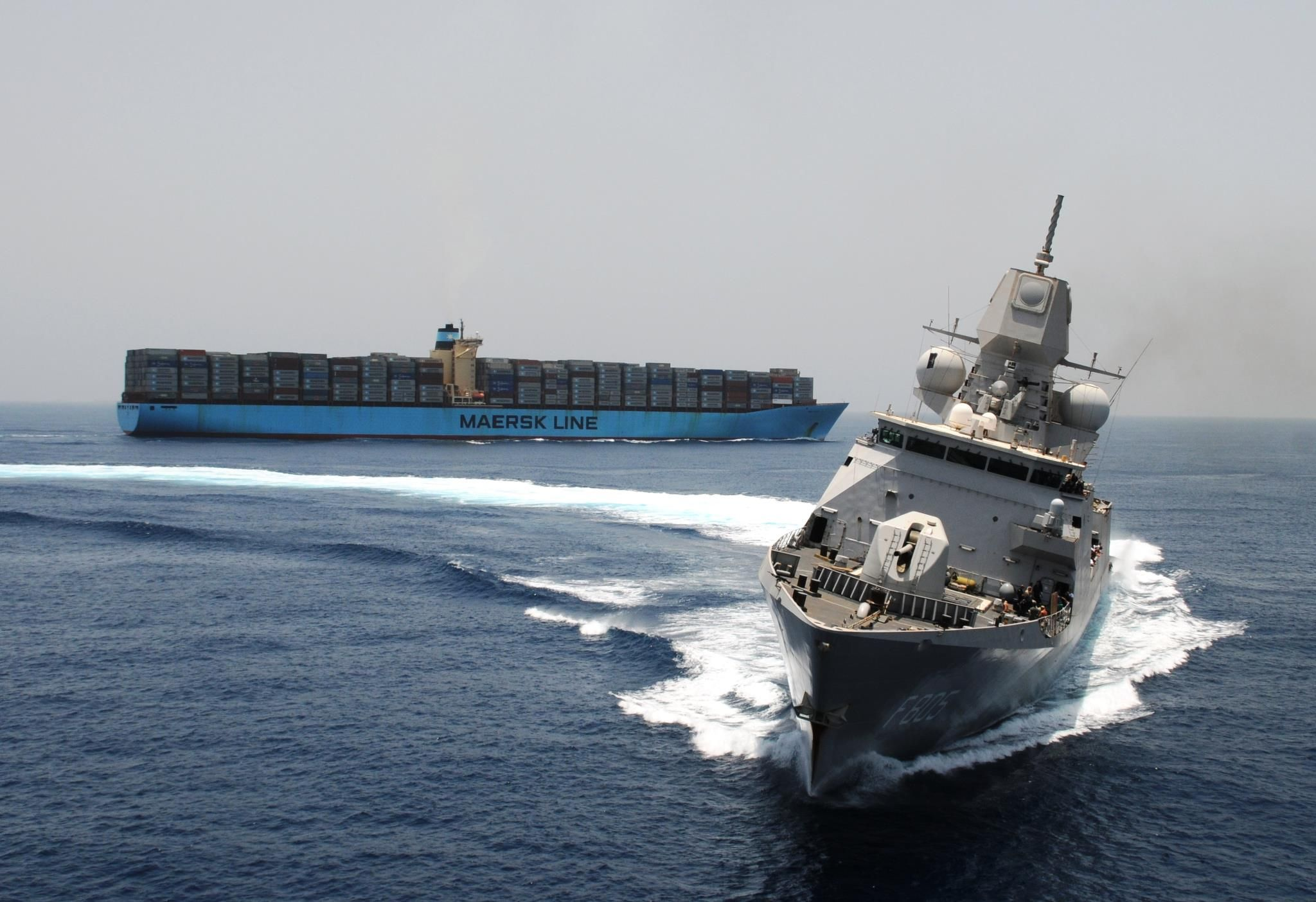Maersk Line vessel and a naval ship in the Gulf of Aden, off the coast of Somalia.