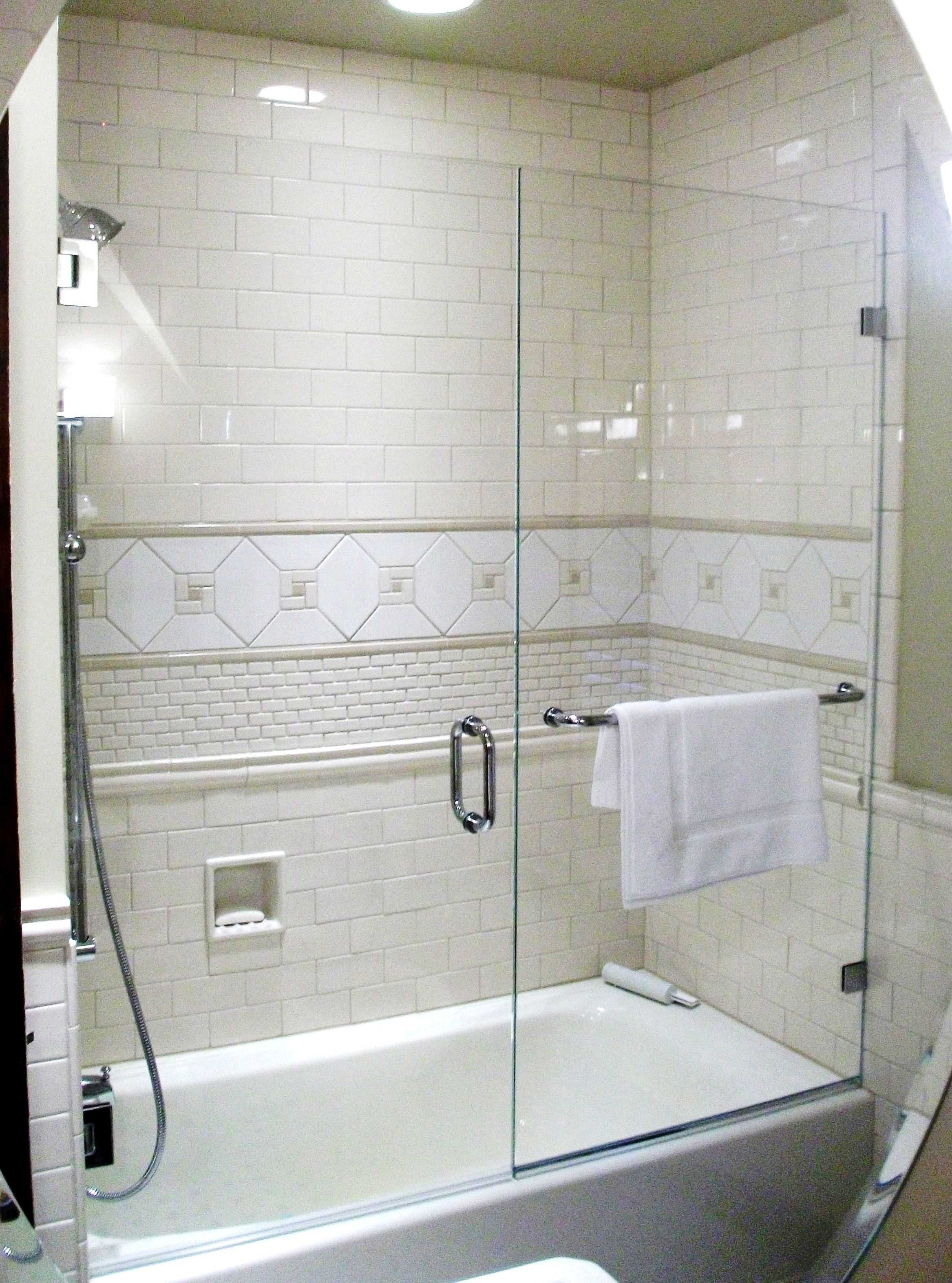 Frameless Shower Enclosure Door Panel On Tub With Wall Mount