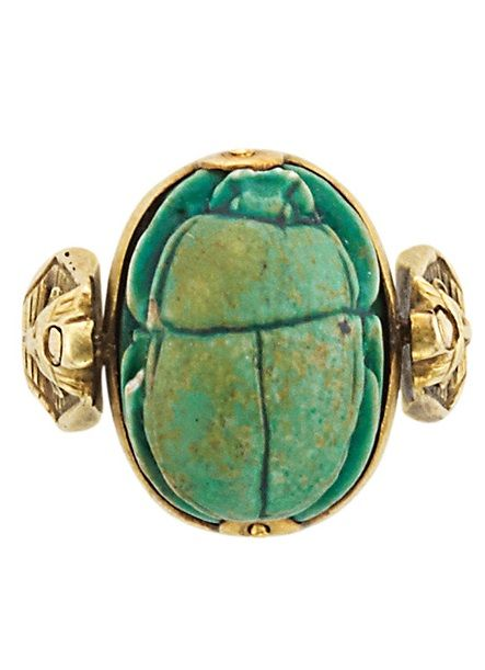 Egyptian Revival Gold and Faience Scarab Ring. 18 kt., with articulated faience, circa 1920.
