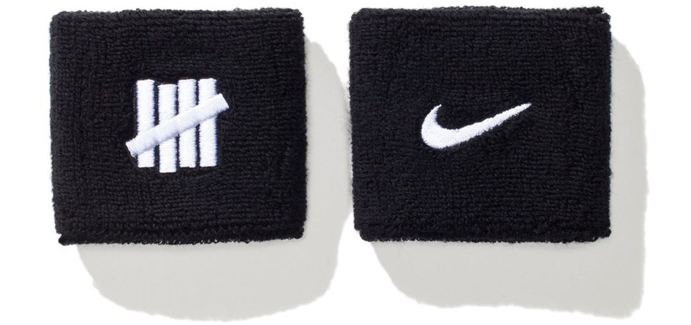Check out the Undefeated x Nike Wristband Black available on StockX ... b33f7a89a35