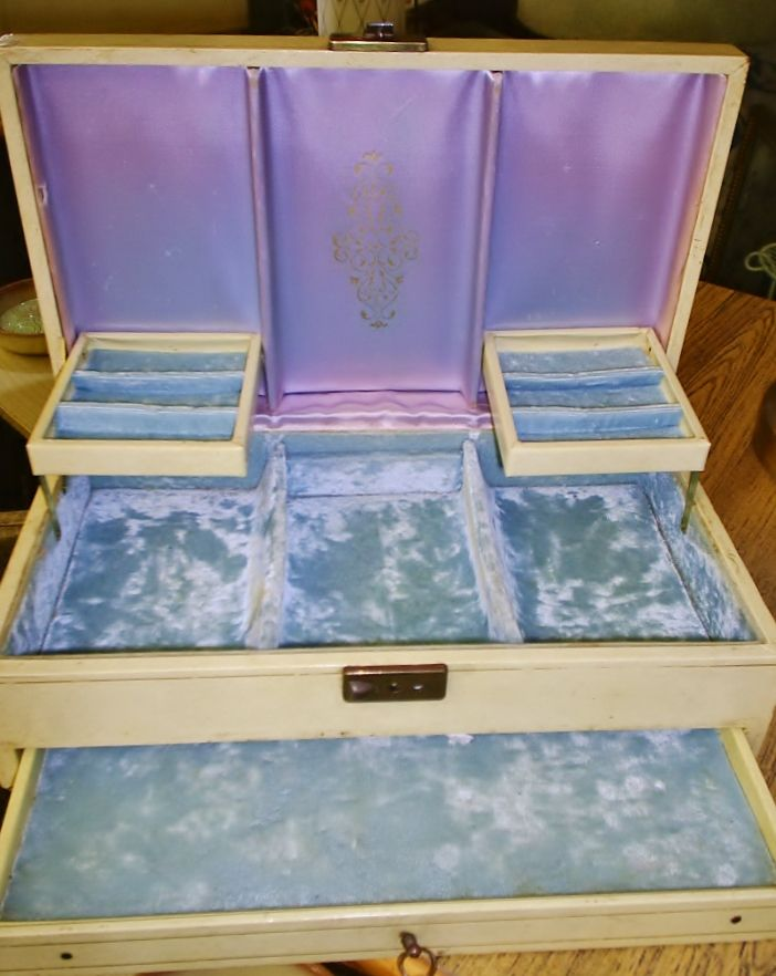 Cute vintage jewelry box with powder blue satin and velvet lining