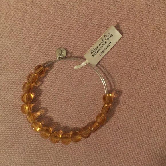 Alex & Ani citrine bracelet Alex & Ani citrine stone bracelet with silver detail.  NWT !  Unique design adjusts to fit every wrist! Alex & Ani Jewelry Bracelets