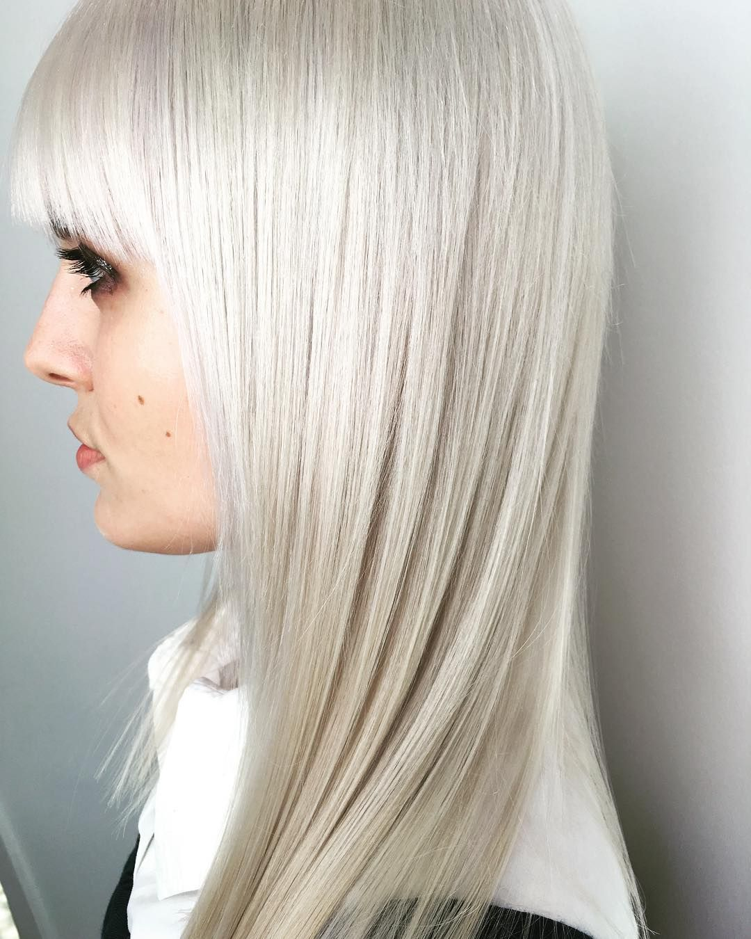 A Frosted Blonde Hair Color Finished Off With Razor Sharp Glass