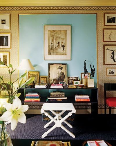 Framed turquoise on the wall is used as backdrop for the painting.  Love it!