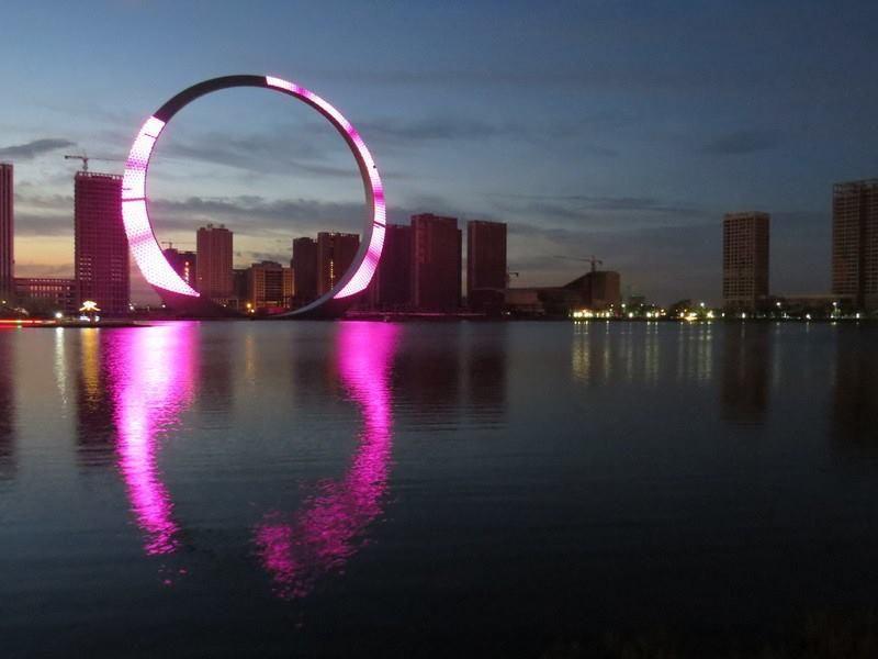 """Ring of Life"" Fushun city, China (at night - pink) • ""StarGate""-like 157mh (115ft) / 3T / 12k LEDs / elevators / $16M (only?)"