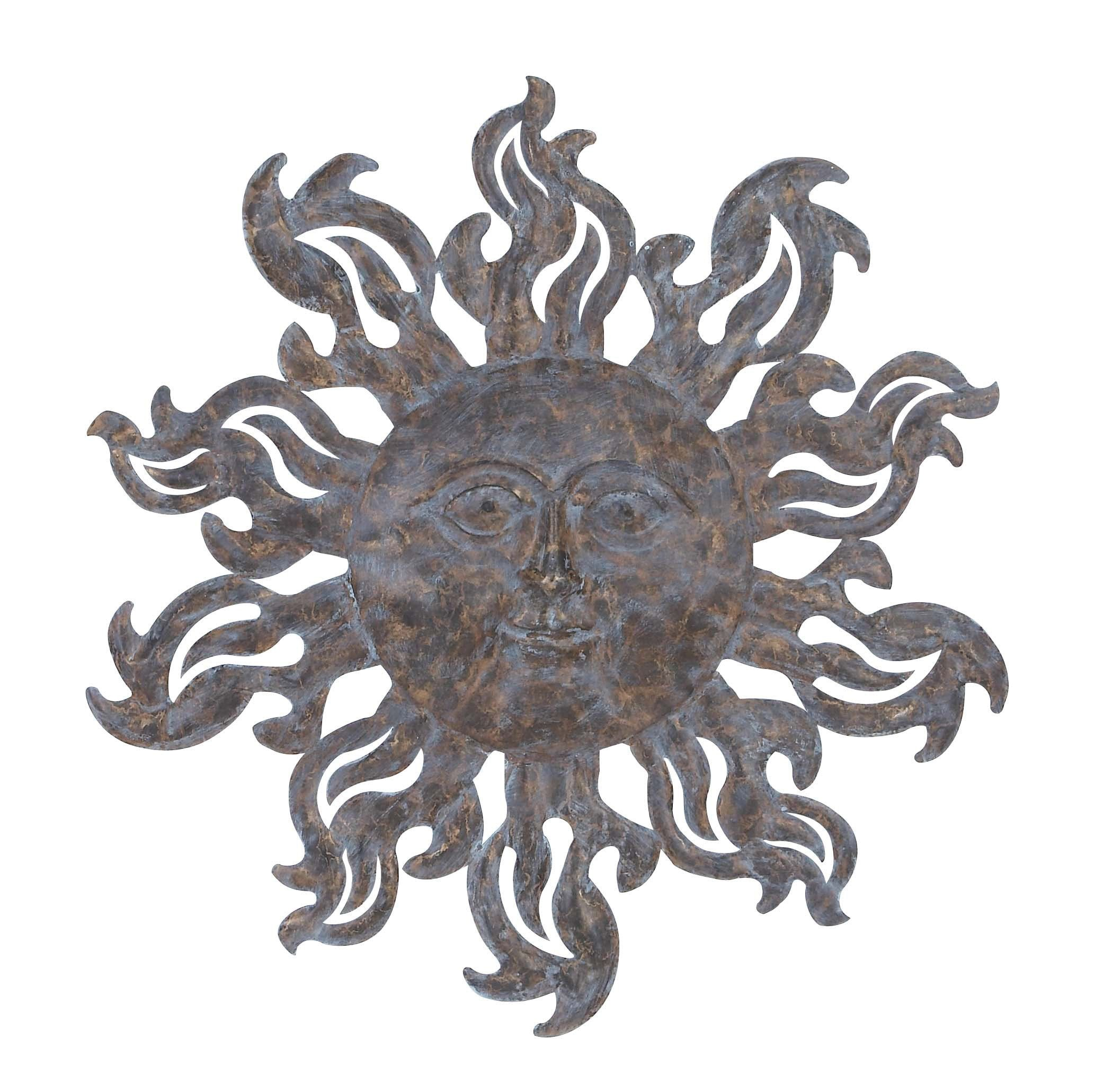 Metal sun wall decor with burnished blue highlights oakville house