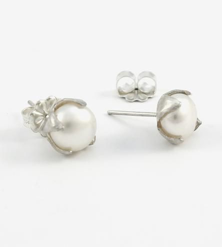 Made to look a whole lot like the cotton plant, these handcrafted earrings swap out the white, fluffy stuff for freshwater pearls. The pearls are set in a hand-sculpted setting, the curved prongs shaped like the protective boll casing. With their nature-inspired shape, the earrings are organic, and a touch more rustic than your classic pearl studs.