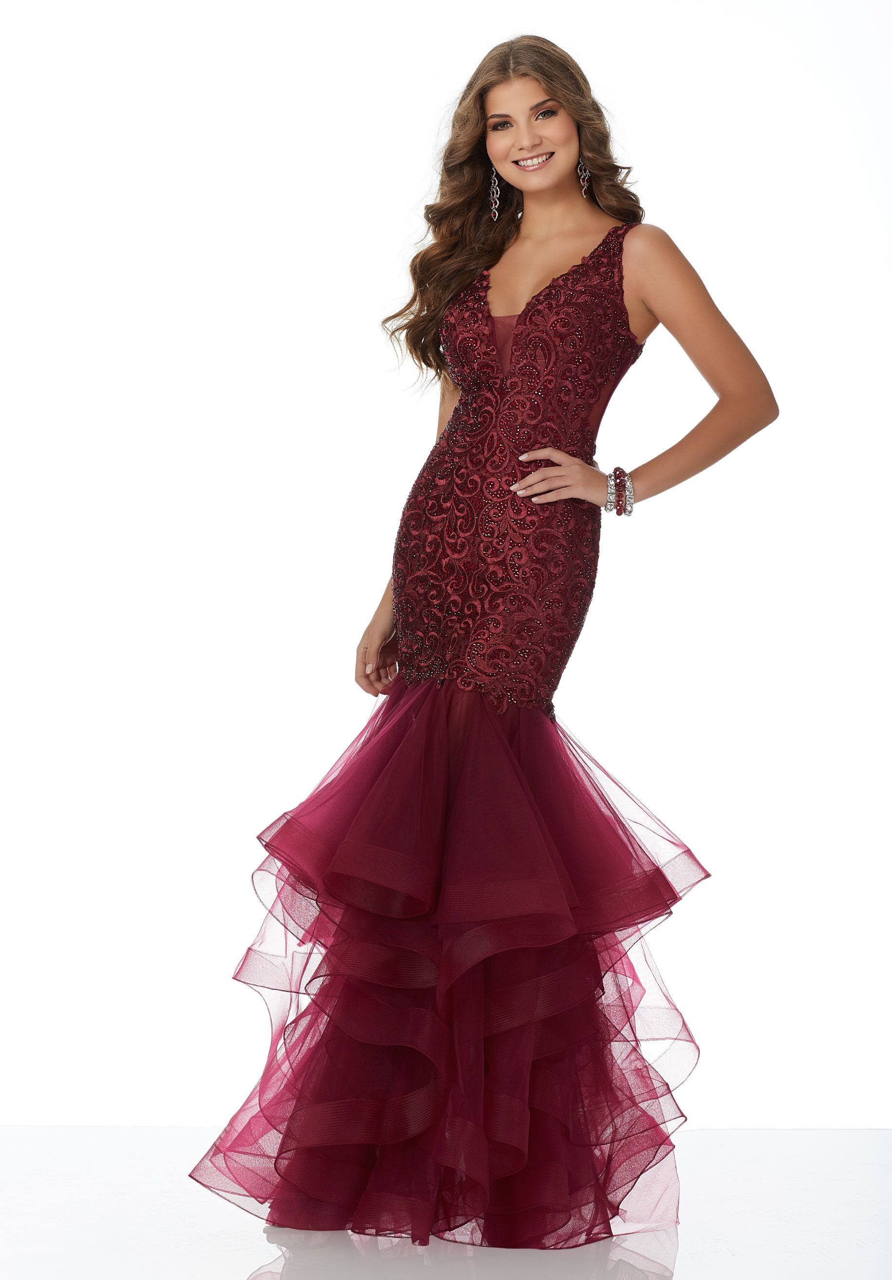 6dcaeb958a Form Fitting Mermaid Prom Gown Featuring a Fully Embroidered and Beaded  Bodice with Sheer Back. A Ruffled Tulle Skirt Trimmed in Horsehair  Completes the ...