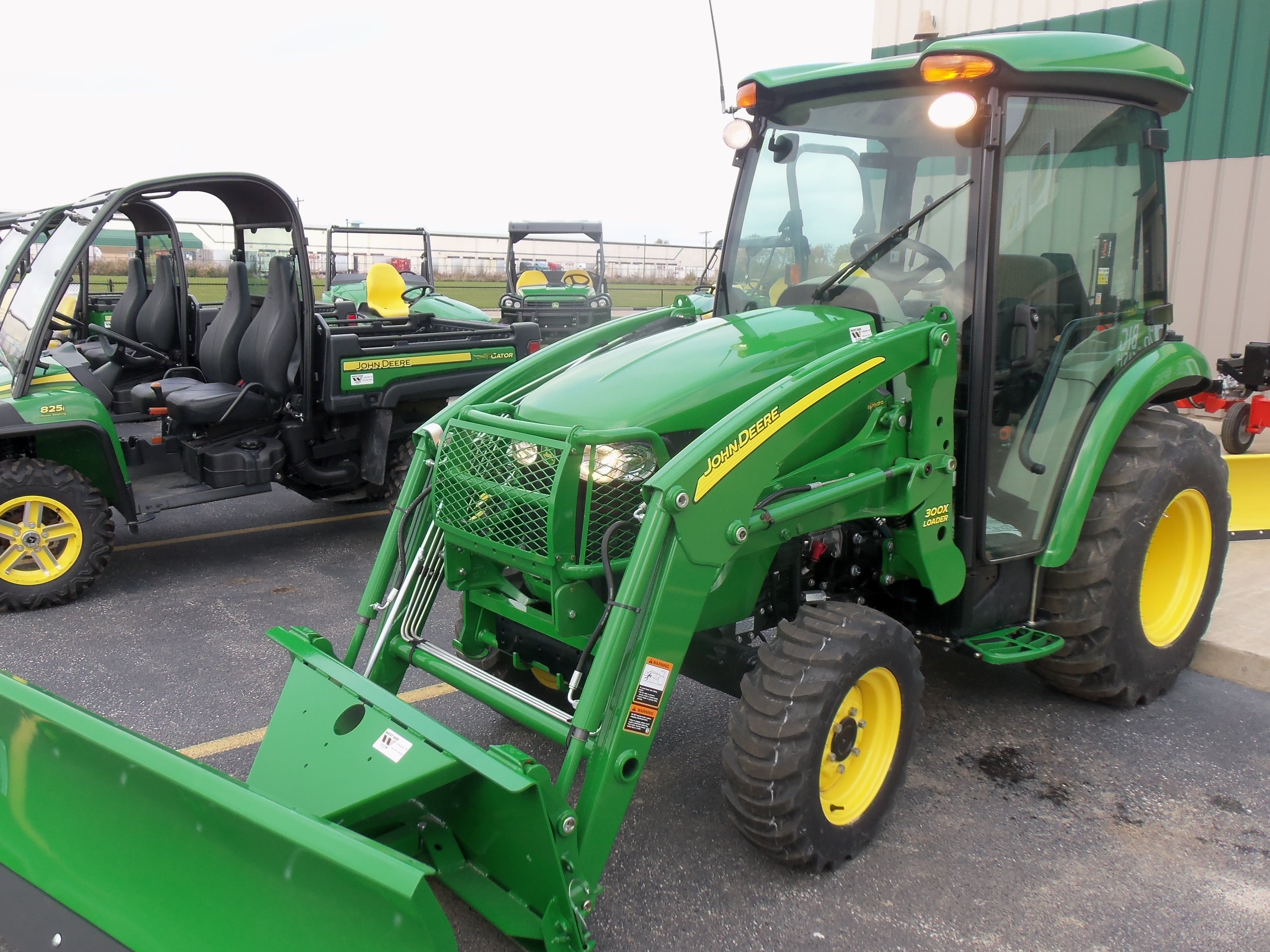 John Deere 3320 cab tractor with lights on.33 engine, 26 PTO hp,3,570 lbs