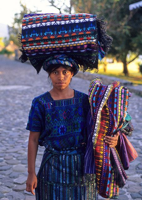 a Maya woman sells textiles to visitors to Panajachel Guatemala