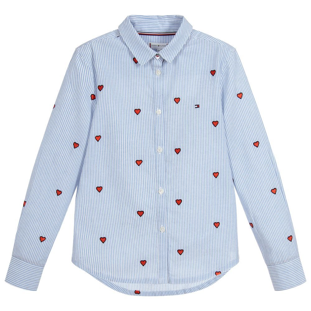 1b5851ad07bc94 Girls blue striped shirt by Tommy Hilfiger, with a gorgeous embroidered red  heart pattern. Made in soft cotton, it has the iconic Tommy Hilfiger flag  ...