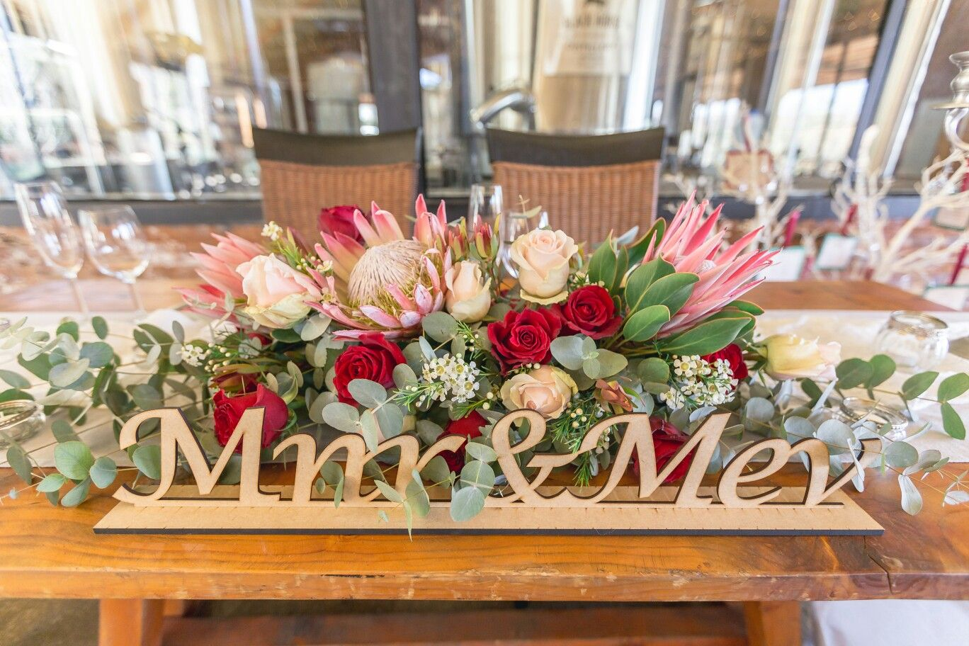Bride And Groom Table Flower Arrangement With Proteas And Roses Table Flower Arrangements Wedding Table Flowers Brides Table
