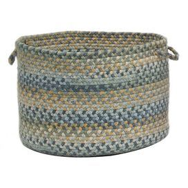 "Hand-braided utility basket in whipple blue. Made in the USA.      Product: Storage basket    Construction Material: Cotton and polyester    Color: Whipple blue     Features:   Hand-braided   Made in the USA    Dimensions: 12"" H x 18"" Diameter"