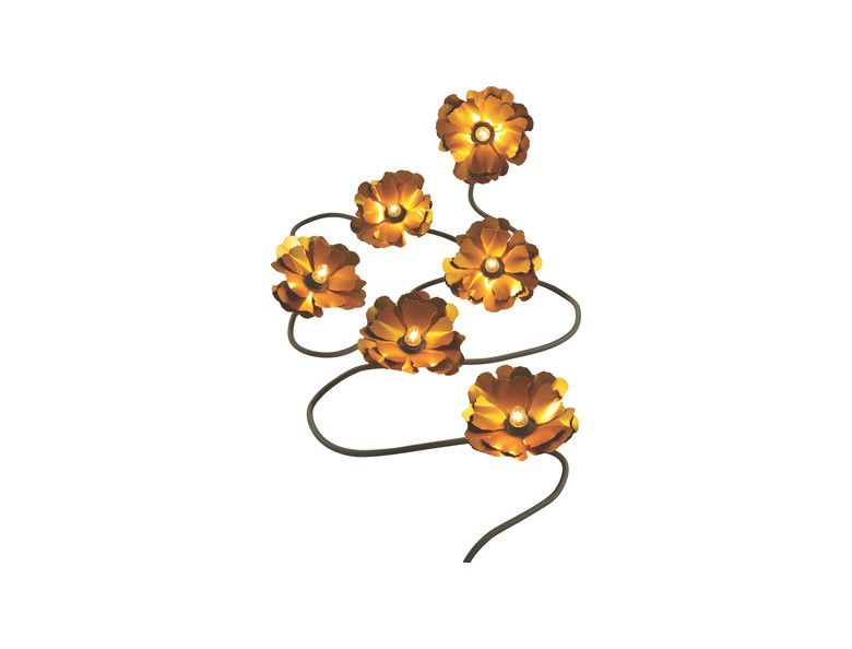 Leave it to helena christensen to create the chicest floral garland lights and leave you basking in a beautiful golden glow helena christensen for habitat