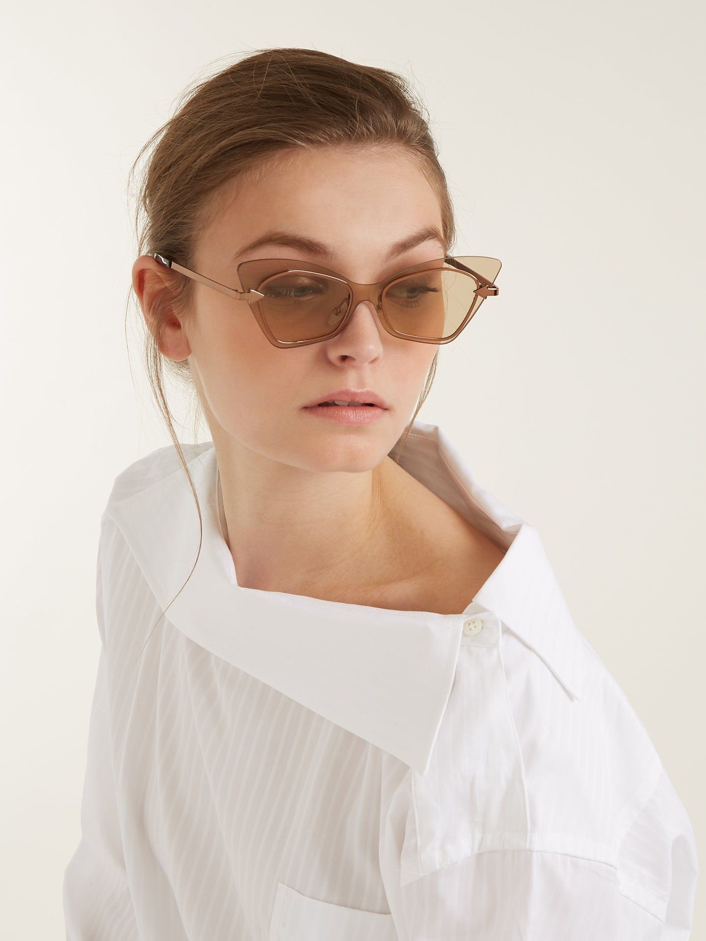 8e04592411 Karen Walker Eyewear s cat-eye Mrs Brill sunglasses are selected from the  designer s  Lost