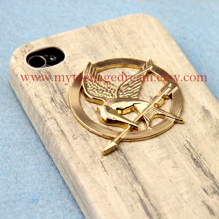 Hunger Games golden Logo Mockingjay pendant cream iPhone case, via Etsy.