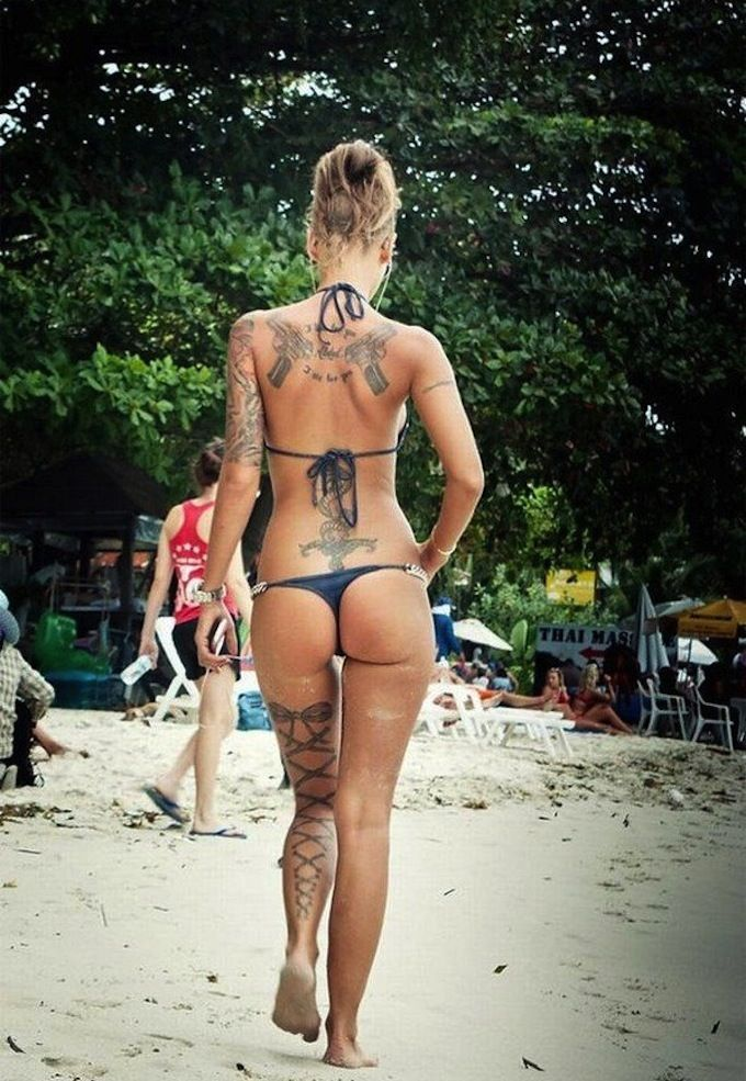 You mean? tattooed nude girl beach can