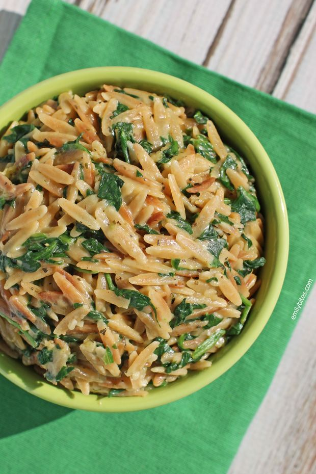 4 SmartPoints – This cheesy Spinach and Parmesan Orzo is the perfect quick and easy recipe for a weeknight side dish. A great pair for grilled meats - perfect for Spring and Summer! www.emilybites.com #healthy