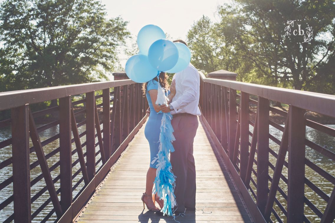 Gender reveal photo shoot! It's a boy! Blue balloons and tassel streamers! Baby Gray!