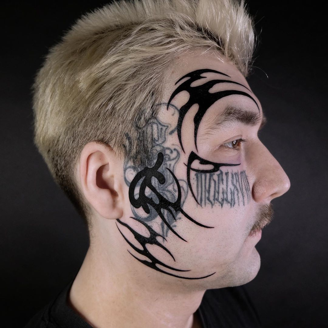 Tribal tattoo face tatts never get out of style. tyson
