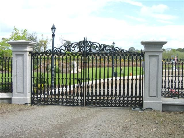 Transitional Style Driveway Gate With A Sleek Black Finish And