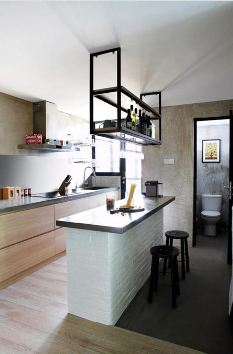 Kitchen hanging rack and brick counter  Interiors in