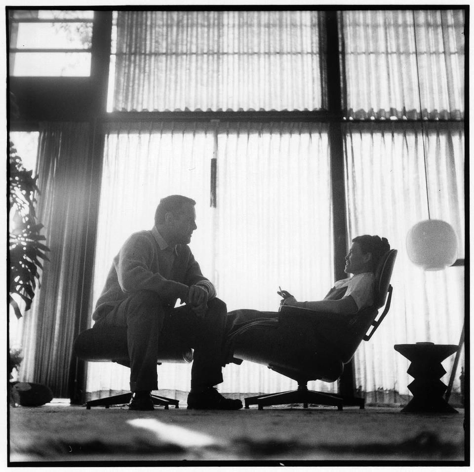 Charles & Ray Eames on a Lounge Chair and Ottoman in their house. © Vitra / Eames Office
