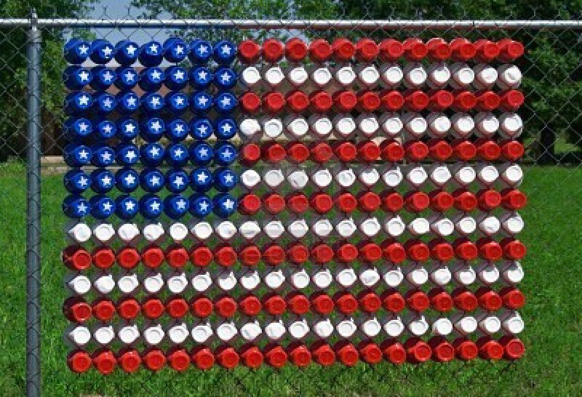 A US flag made of plastic cups in a chain link fence. by kazberry ...