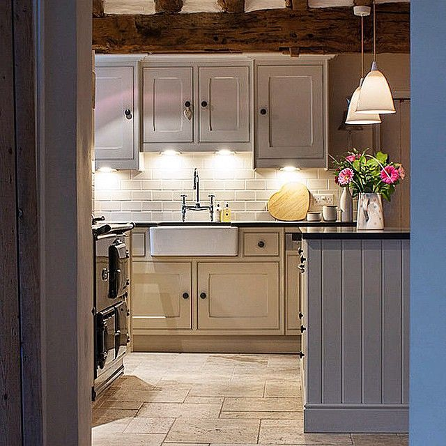 Interior: A simple hand painted kitchen with black AGA cooker and ...