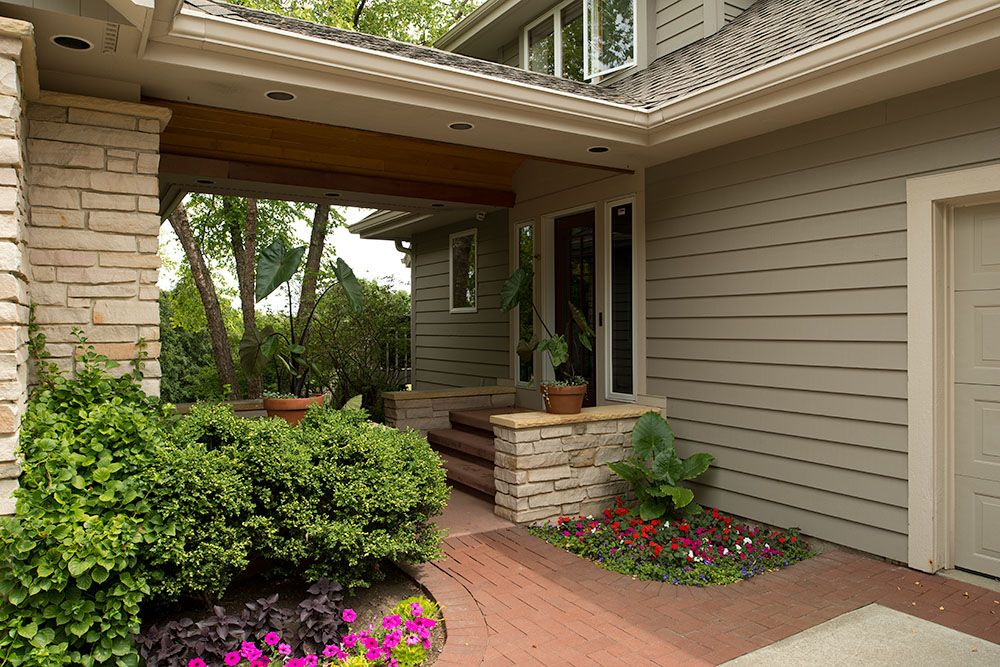 A breezeway separates the two garages and provides a for House with detached garage and breezeway