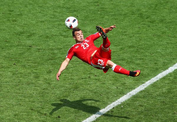 Xherdan Shaqiri of Switzerland scores his team's first goal during the UEFA EURO 2016 round of 16 match between Switzerland and Poland at Stade Geoffroy-Guichard on June 25, 2016 in Saint-Etienne, France.