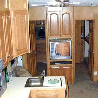 Looking into the Titaniums two small bedrooms in the rear of the fifth wheel.
